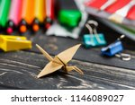paper bird on the table among... | Shutterstock . vector #1146089027