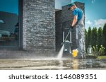 Pressure washer cleaning in...