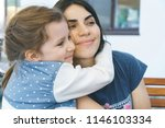 smiling daughter hugging mother ... | Shutterstock . vector #1146103334