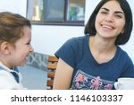 laughing mother and daughter... | Shutterstock . vector #1146103337