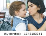 mother and daughter talking at... | Shutterstock . vector #1146103361