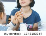 gilr holding woman's hand at... | Shutterstock . vector #1146103364