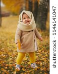 cute happy girl in autumn park | Shutterstock . vector #1146141047