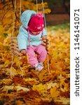 little girl on swings in autumn ... | Shutterstock . vector #1146141071