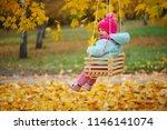 little girl on swings in autumn ... | Shutterstock . vector #1146141074