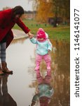 little girl with rubber boots... | Shutterstock . vector #1146141077