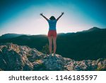 the girl at the top of the... | Shutterstock . vector #1146185597