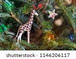 Giraffe Holiday Ornament On Tree