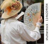Woman Using A Fan