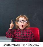 funny little child in glasses... | Shutterstock . vector #1146229967