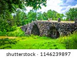 ancient stone bridge in deep... | Shutterstock . vector #1146239897