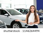 young saleswoman standing in... | Shutterstock . vector #1146264494