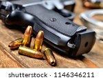 close up of 9mm pistol  bullets ...   Shutterstock . vector #1146346211