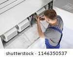 young male technician repairing ... | Shutterstock . vector #1146350537