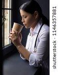 pretty asian doctor sips on her ... | Shutterstock . vector #1146357881