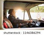 senior hipster driving a van by ...   Shutterstock . vector #1146386294