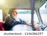 senior hipster driving a van by ... | Shutterstock . vector #1146386297