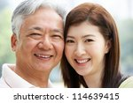 portrait of chinese father with ... | Shutterstock . vector #114639415