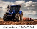 tractor preparing land for... | Shutterstock . vector #1146409844