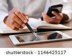 closeup of person pointing pen... | Shutterstock . vector #1146425117