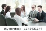 business team holds a workshop... | Shutterstock . vector #1146431144
