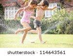 Two Children Running Through...