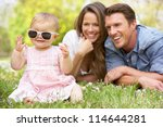 parents with baby girl sitting... | Shutterstock . vector #114644281