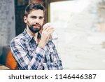 young handsome man enjoying...   Shutterstock . vector #1146446387
