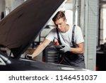 a good looking blond mechanic... | Shutterstock . vector #1146451037