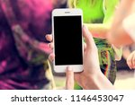 woman's hands are holding a... | Shutterstock . vector #1146453047