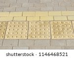 yellow tactile path for people... | Shutterstock . vector #1146468521