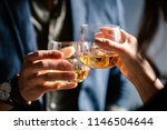 man and woman celebrating with... | Shutterstock . vector #1146504644