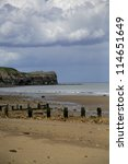 Breakwaters on Sandsend beach near Scarborough - stock photo