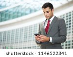 young businessman using his... | Shutterstock . vector #1146522341