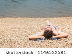 young man laying on the sandy... | Shutterstock . vector #1146522581
