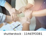 the hand on hand of the... | Shutterstock . vector #1146593381