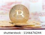 golden bitcoins against 5000... | Shutterstock . vector #1146676244