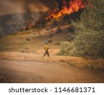 Firefighter Working On A Fire...