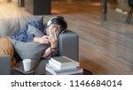 young asian man using... | Shutterstock . vector #1146684014