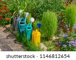 multicolored watering cans | Shutterstock . vector #1146812654