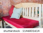 red cushion on indoors wooden... | Shutterstock . vector #1146831614