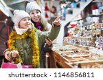 smiling girl with woman are... | Shutterstock . vector #1146856811