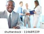 portrait of happy boss looking... | Shutterstock . vector #114689239