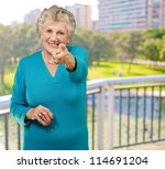 portrait of woman pointing her... | Shutterstock . vector #114691204