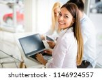 three young smiling colleagues... | Shutterstock . vector #1146924557