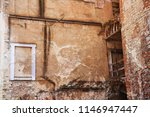 facade of ancient ruined... | Shutterstock . vector #1146947447