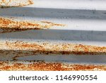 rusty corrugated metal roofing | Shutterstock . vector #1146990554