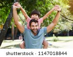 dad and little dude playing in... | Shutterstock . vector #1147018844