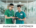 two asian health professionals...   Shutterstock . vector #1147034624