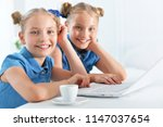 two adorable twin sisters | Shutterstock . vector #1147037654